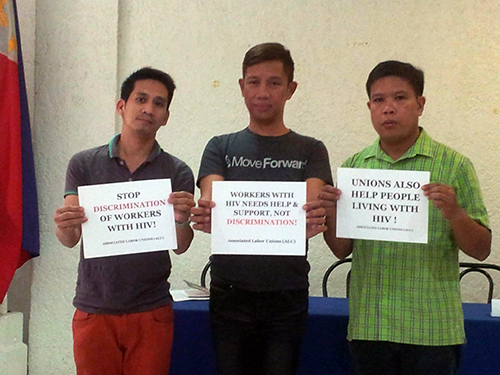 Former Ricky Reyes employee Rene Nocos (in the middle) is flanked by Noel Quinto of Pinoy Plus Foundation (PPF) and Associated Labor Unions (ALU) policy advocacy officer and Trade Union Congress of the Philippines spokesperson Alan Tanjusay (in green polo shirt). Pinoy Plus and ALU-TUCP expressed support to Nocos and commended him for his courage to come out in the public. This photo was taken after the press conference today July 1, 2015. Photo credit to Glenda Ariate of the Associated Labor Unions.